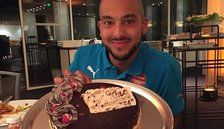 Theo Walcott shows off cake from Arsenal team-mates on Instagram as Mesut Ozil wishes him happy birthday on Twitter